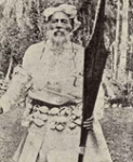 king fata-a-iki of niue in full dress holding a katoua war club who reigned until his death on the 15th january 1896.